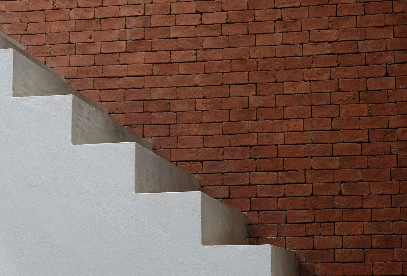 Stairs and brick wall