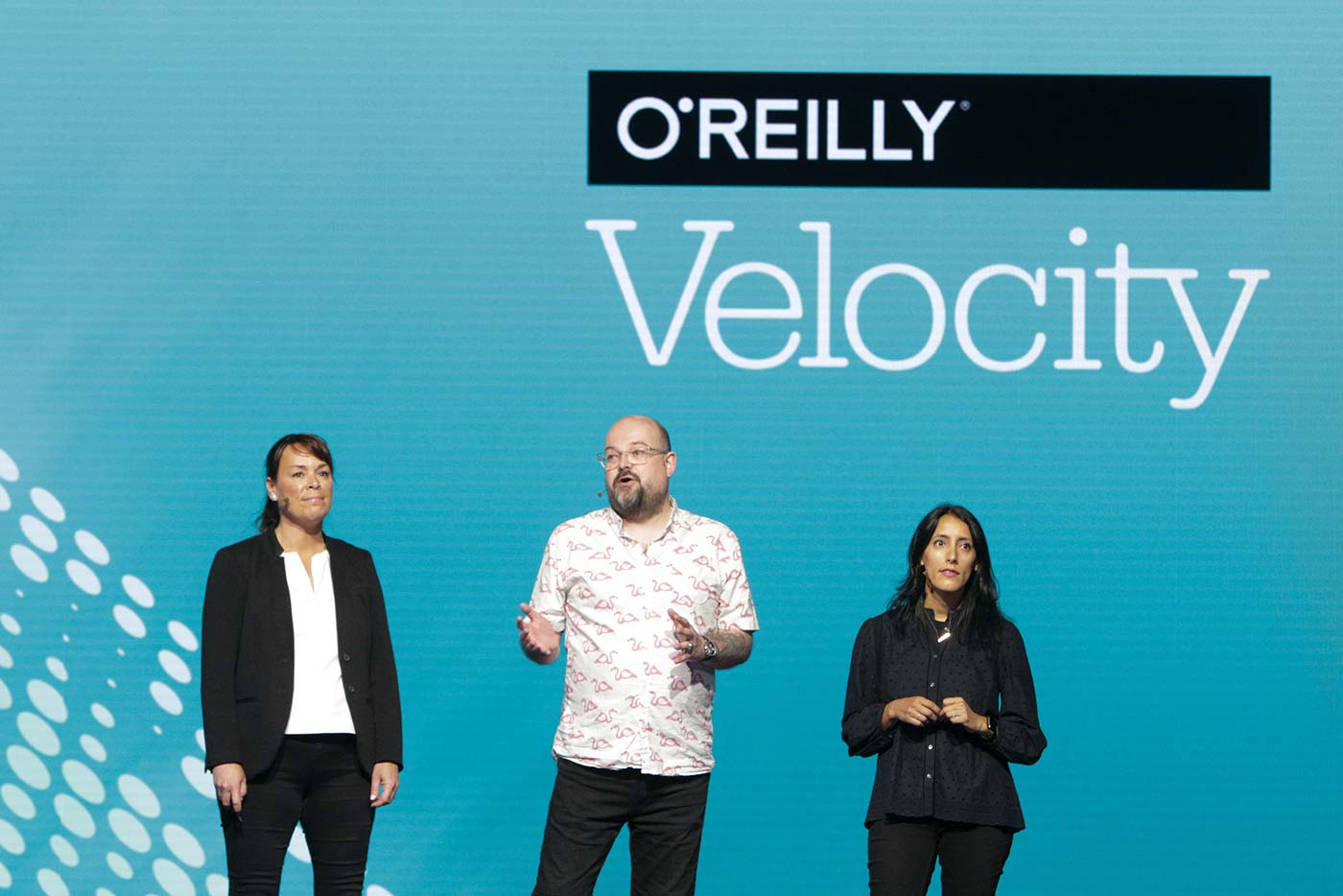 L to R: Velocity chairs Mary Treseler, James Turnbull, and Ines Sombra at the O'Reilly Velocity Conference in San Jose 2017.